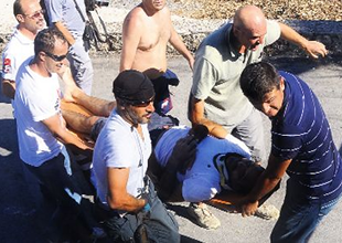 Paraşüt eğitmeni Konyaaltı plajına düştü